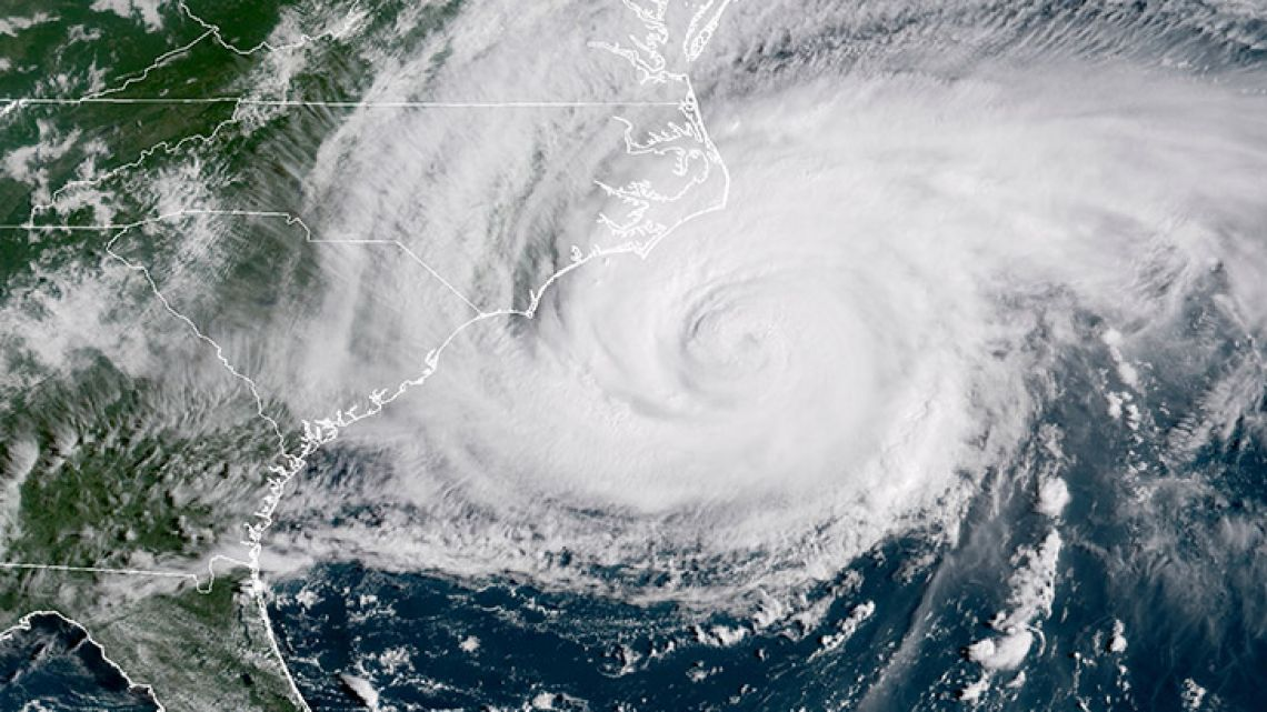 This satellite image provided by NOAA shows Hurricane Florence on the eastern coast of the United States on Friday, September 14, 2018.