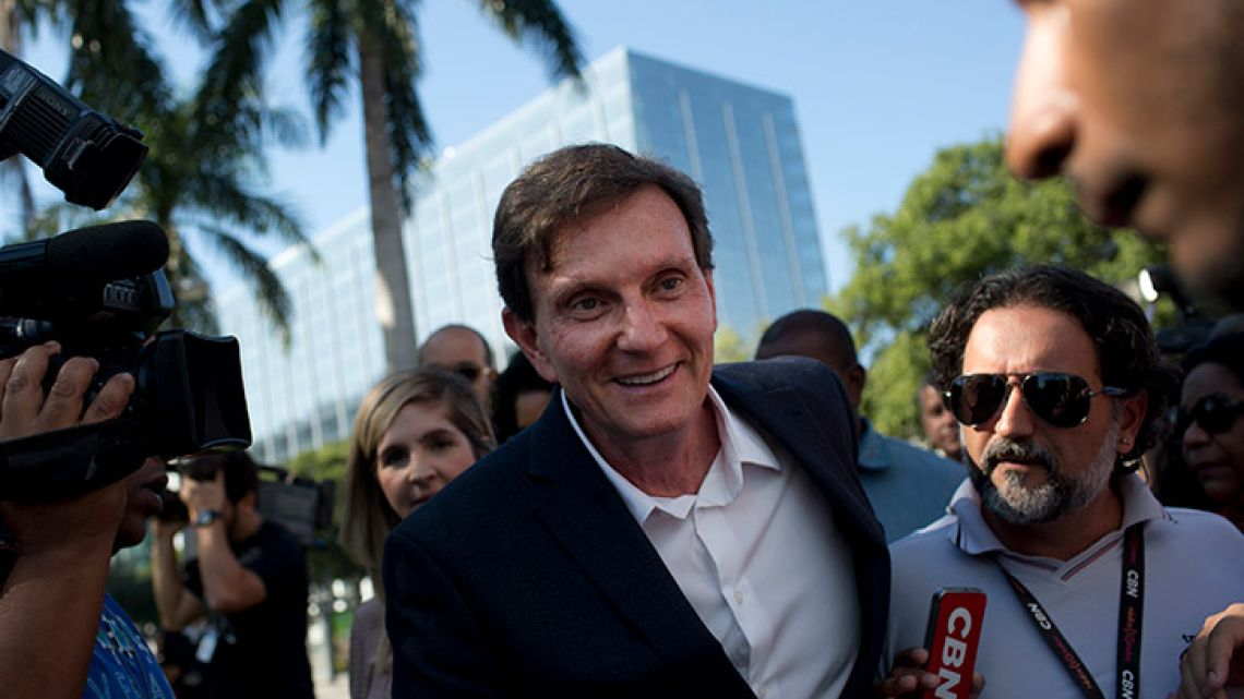 Marcelo Crivella talks with the media in Rio de Janeiro, Brazil. Evangelical voters helped propel Crivella, a bishop in the Universal Church of the Kingdom of God, to mayor of Brazil's most famous city in 2016.