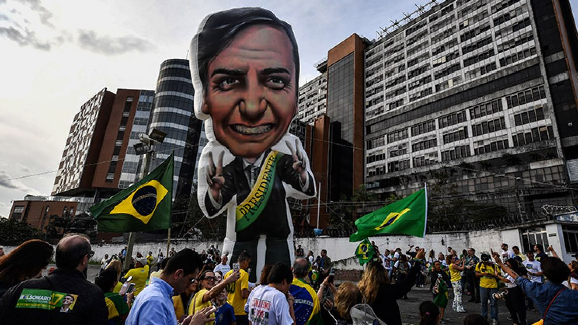 Supporters of Brazilian right-wing presidential candidate Jair Bolsonaro gather in front of the Israelita Albert Einstein Hospital in São Paulo, Brazil, after it was announced that their stabbed leader had left the intensive care unit.