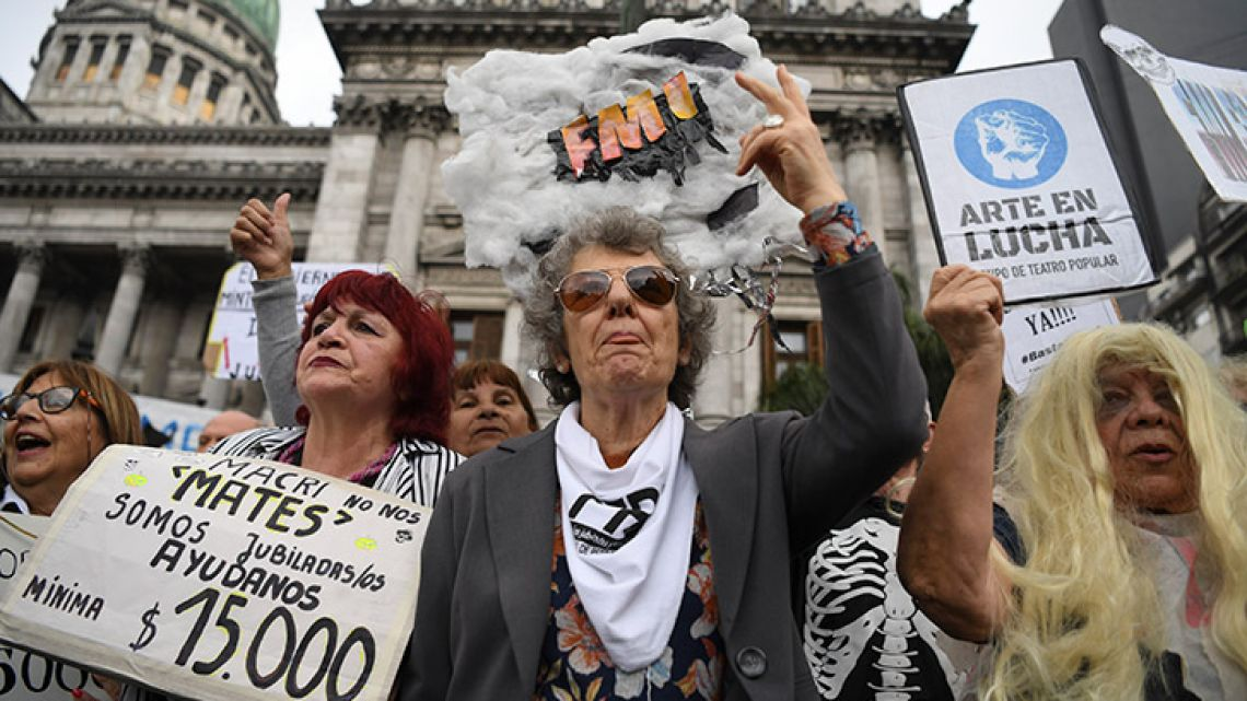 Retirees protest outside the National Congress in Buenos Aires, against the government's agreement with the International Monetary Fund (IMF) and in demand for a raise in their pensions.