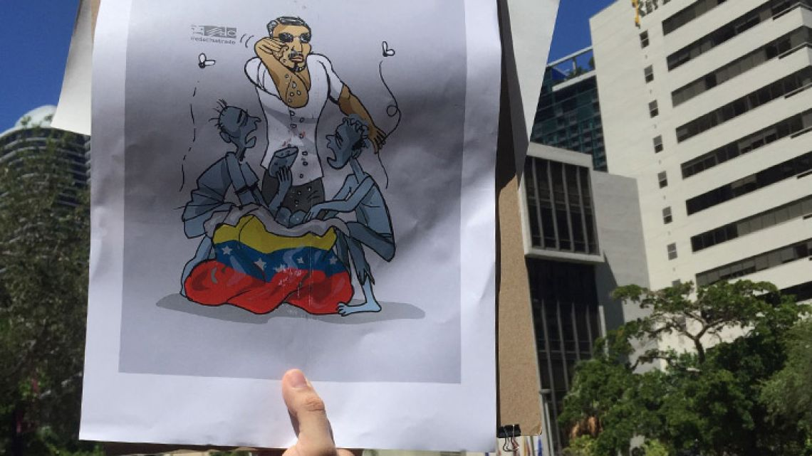 Venezuelans protest in front of the Nusr-Et Steakhouse restaurant in Brickell, near downtown Miami. Nusr-Et's Turkish chef Nusret Gökçe, known as 'Salt Bae,' made waves in the news after he hugged and lavished Venezuelan president Nicolás Maduro in one of his restaurants in Istanbul.