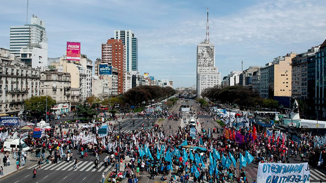 Demonstrators march against the government of Mauricio Macri and his economic policies on Monday.
