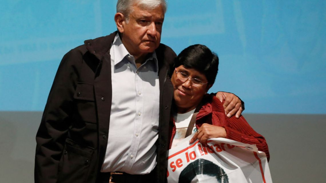 Mexico's President-elect Andrés Manuel López Obrador and María Elena Guerrero, mother of one of the 43 college students who disappeared on September 26, 2014, at the Memory and Tolerance Museum in Mexico City on Wednesday, September 26, 2018.