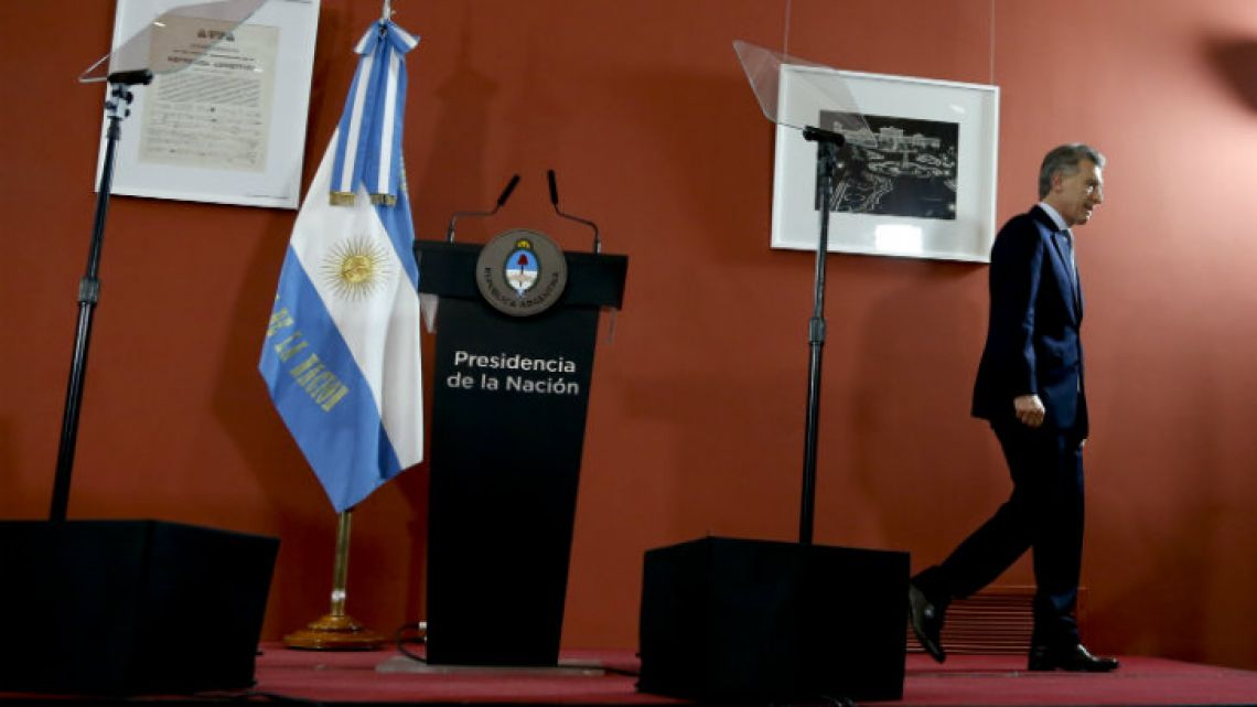 President Mauricio Macri leaves the stage after a press conference at Government House on Thursday.