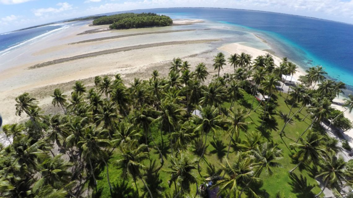 This 2015 photograph shows a large section of land between the trees washed away due to continuing rising sea leaves on Majuro Atoll, Marshall Islands. Small island nations used the weeklong gathering of world leaders at this year's UN General Assembly to highlight the one issue that threatens all of their existence: global warming. On the map, their homes are tiny specks in a vast sea of blue, rarely in the headlines and far removed from the centers of power. But for a few days each year, the leaders of small island nations share the same podium as presidents and prime ministers from the world's most powerful nations, and their message is clear: global warming is already changing our lives, and it will change yours too.