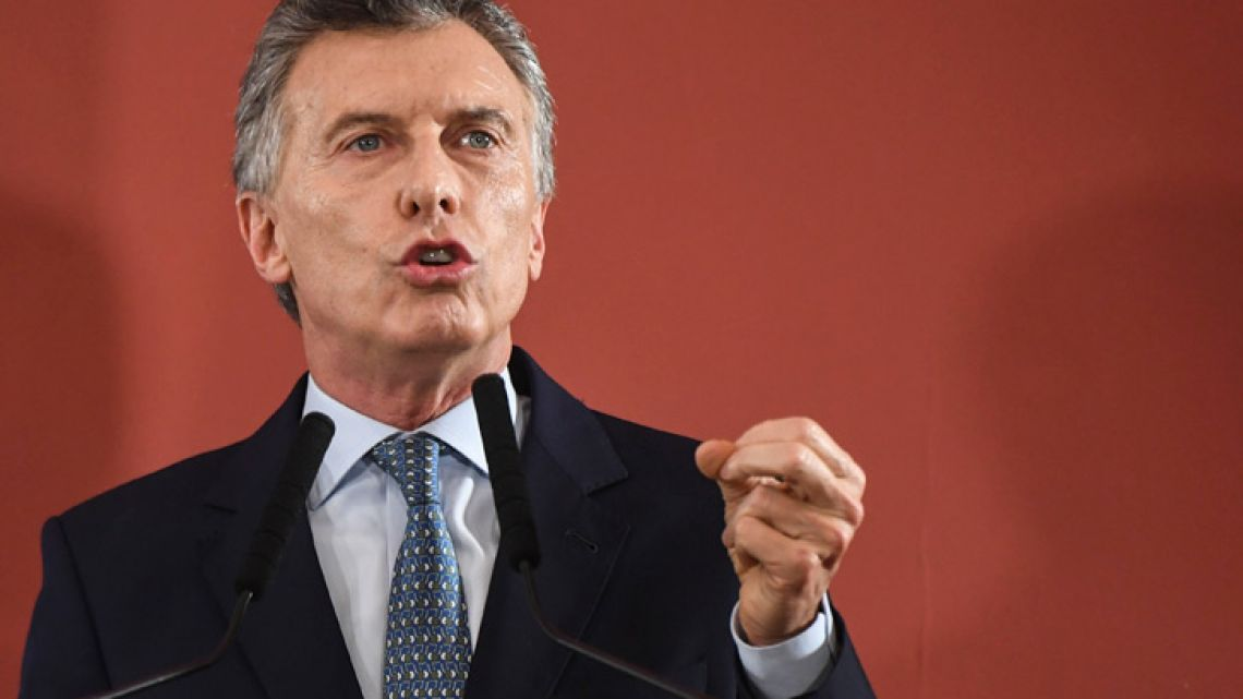 President Mauricio Macri gestures while reading a statement at the Casa Rosada.