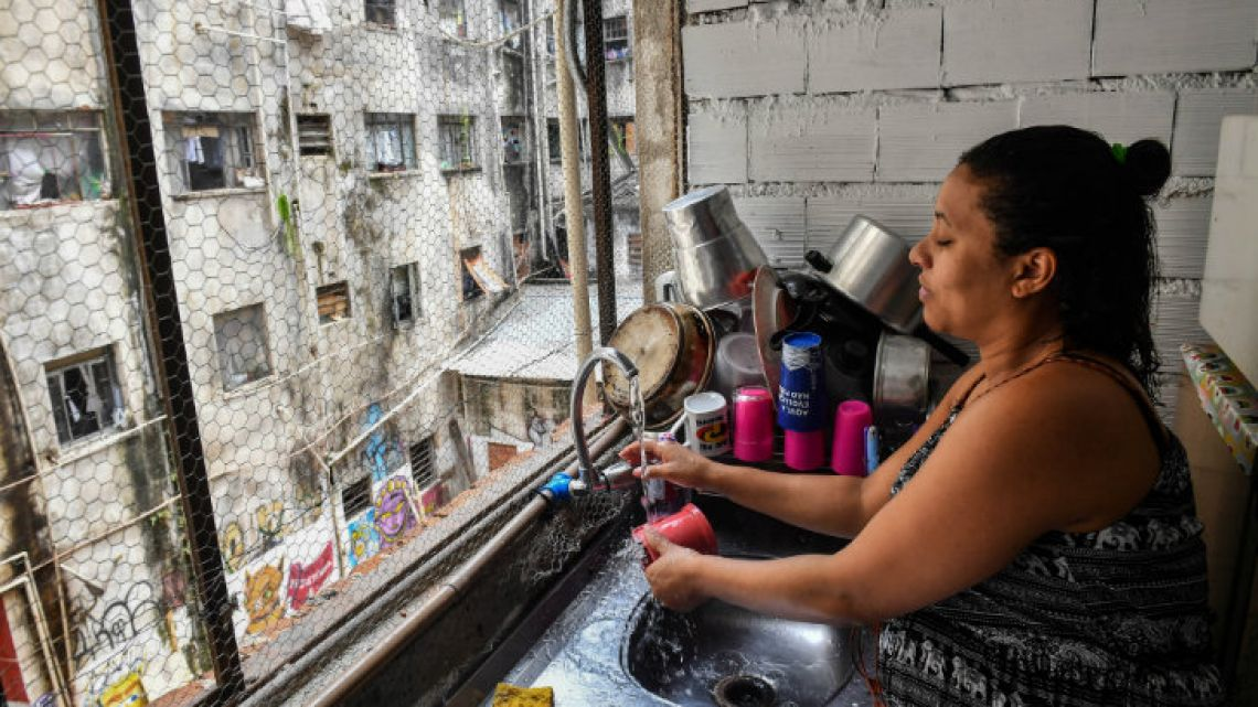 Brazilian Diane Batista, 35, washes dishes at the Maua building, which is occupied by sqatters, in downtown São Paulo.
