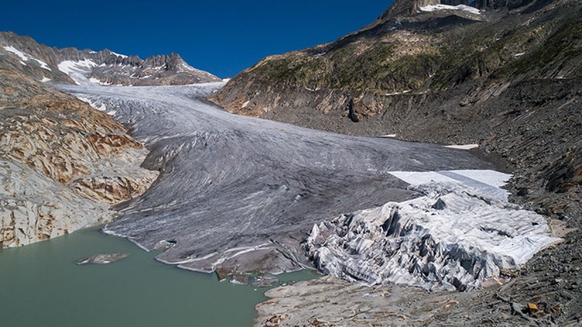 "The Rhone Glacier and its glacial lake, near Gletsch, Switzerland. Avoiding global climate chaos will require a major transformation of society and the world economy that is ""unprecedented in scale,"" the UN said October 8, 2018, in a landmark report that warns time is running out to avert disaster."