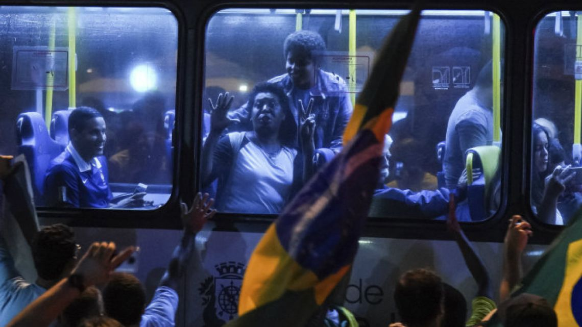 Supporters of Jair Bolsonaro celebrate the election results in front of his house in Rio de Janeiro.