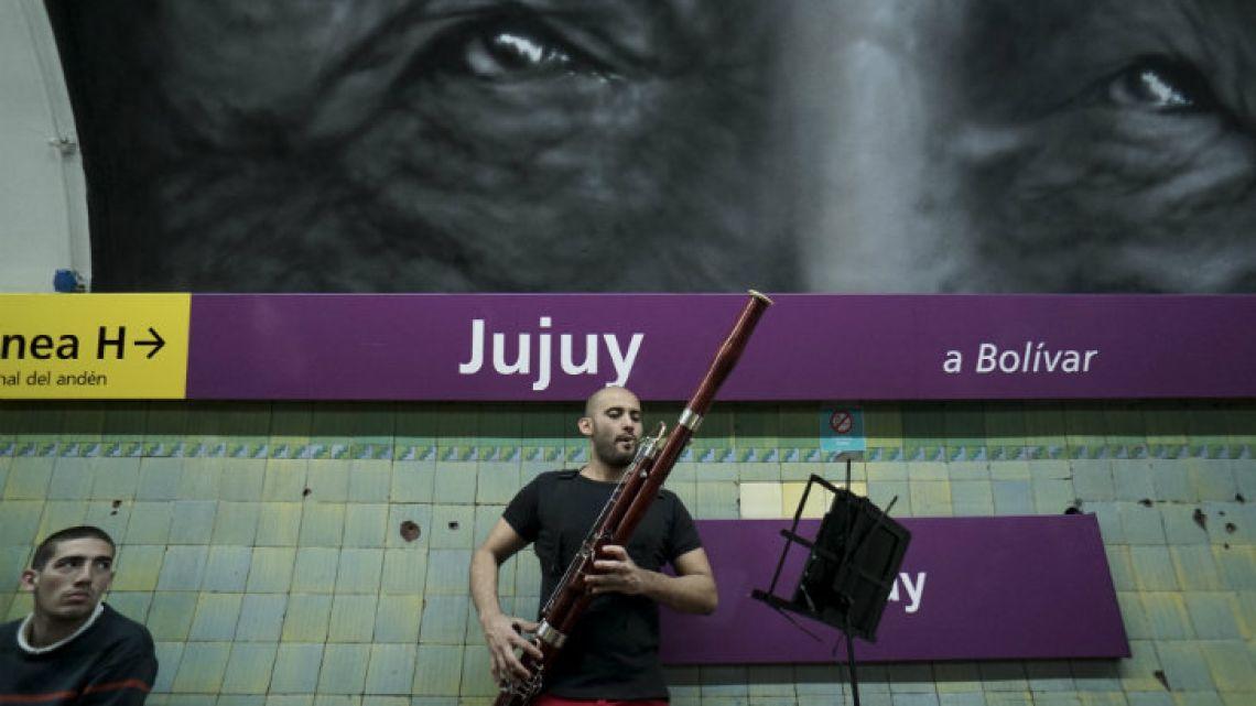 Venezuelan César Pérez, a member of the Latin Vox Machine orchestra, plays the basson at a Subte stop.