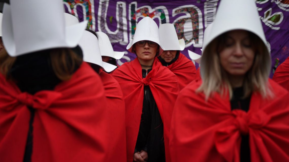 "In this file photo taken on July 25, 2018, activists in favour of the legalisation of abortion disguised as characters from Canadian author Margaret Atwood's feminist dystopian novel ""The Handmaid's Tale"", protest outside the National Congress in Buenos Aires."