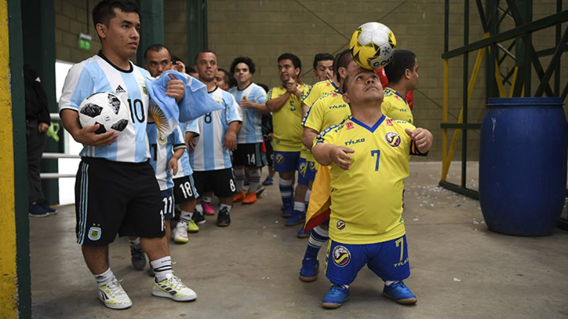 Argentina's and Colombia's football teams line up before the Dwarf Copa América clash at Ferro Carril Oeste Club in Buenos Aires, on October 25, 2018.