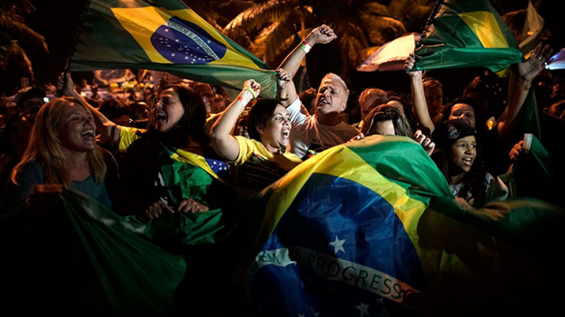 Supporters of Jair Bolsonaro celebrate in front of his residence in Rio de Janeiro.