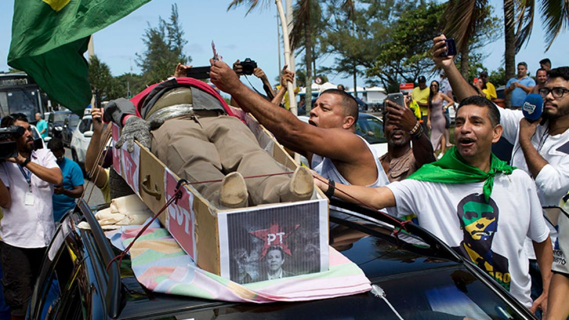 Supporters of Jair Bolsonaro, presidential candidate with the Social Liberal Party, protest with a dummy coffin symbolising the death of the Workers' Party during the presidential run-off election.