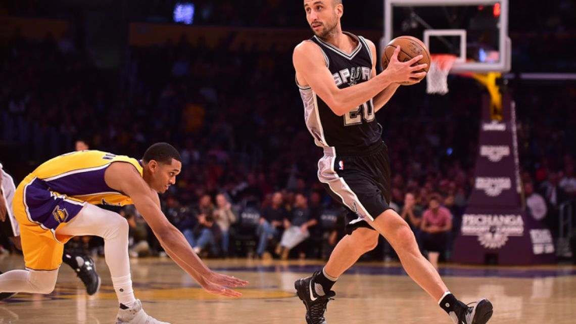 In this photo taken on November 18, 2016, Manu Ginóbili looks to pass during a NBA basketball match.