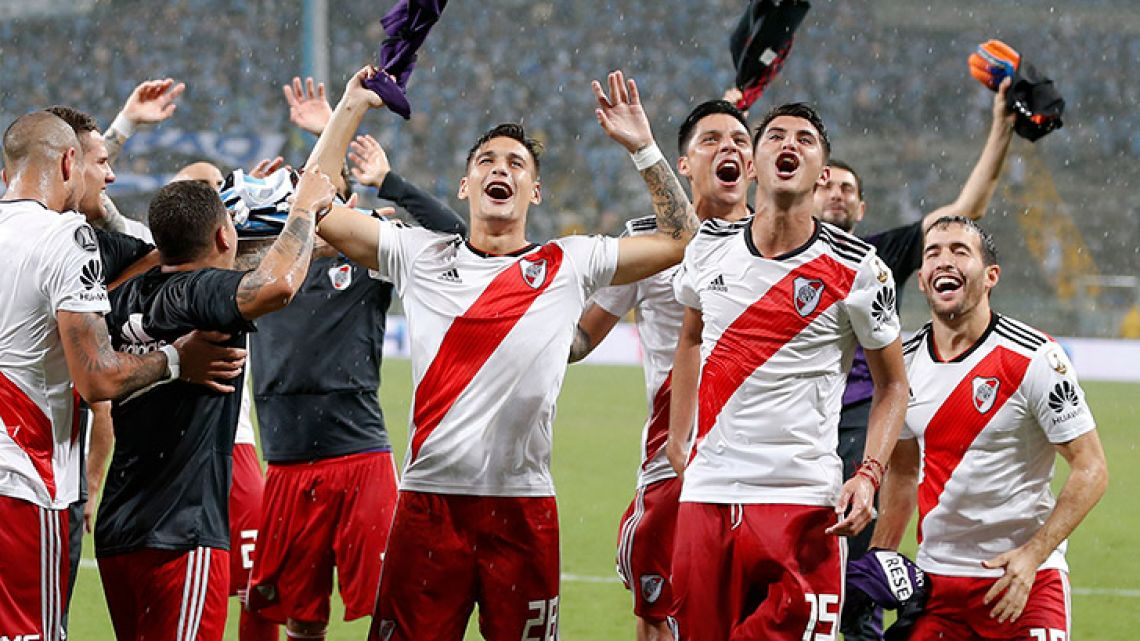 River Plate's players celebrate after defeating Brazil's Grêmio during the semi-final second leg match of the Copa Libertadores in Porto Alegre, Brazil last night.