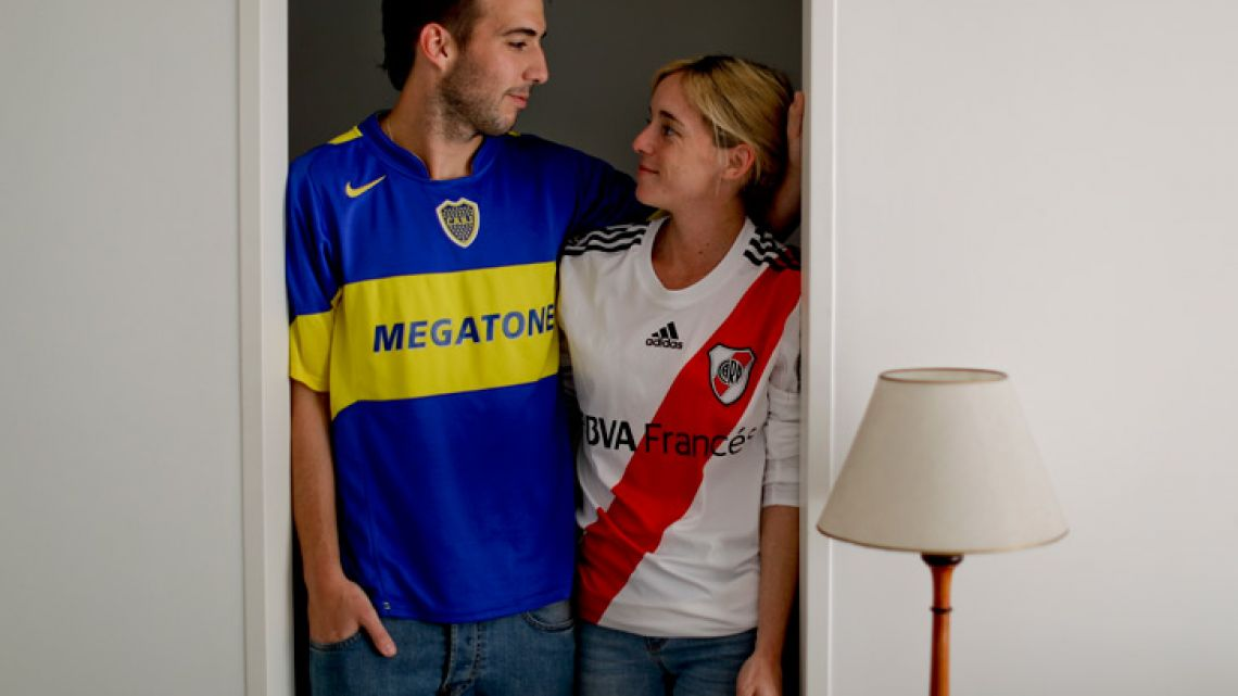 Gonzalo Raffo poses for a picture with his wife Delfina Foramitti. Raffo is a die-hard Boca Juniors fan. His wife passionately roots for River Plate.