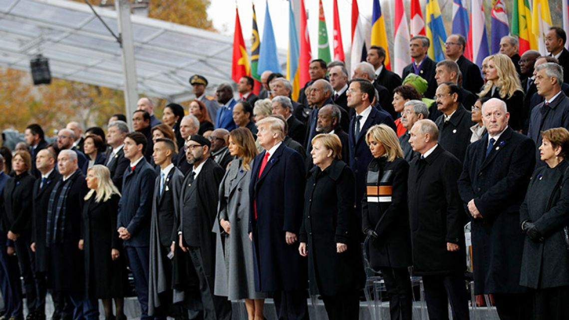 Heads of states and world leaders attend ceremonies at the Arc de Triomphe on Sunday, November 11, 2018 in Paris. Over 60 heads of state and government were taking part in a solemn ceremony at the Tomb of the Unknown Soldier, the mute and powerful symbol of sacrifice to the millions who died from 1914-18.