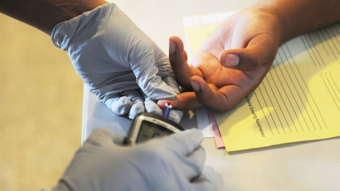 A soldier performs a glucose screening.