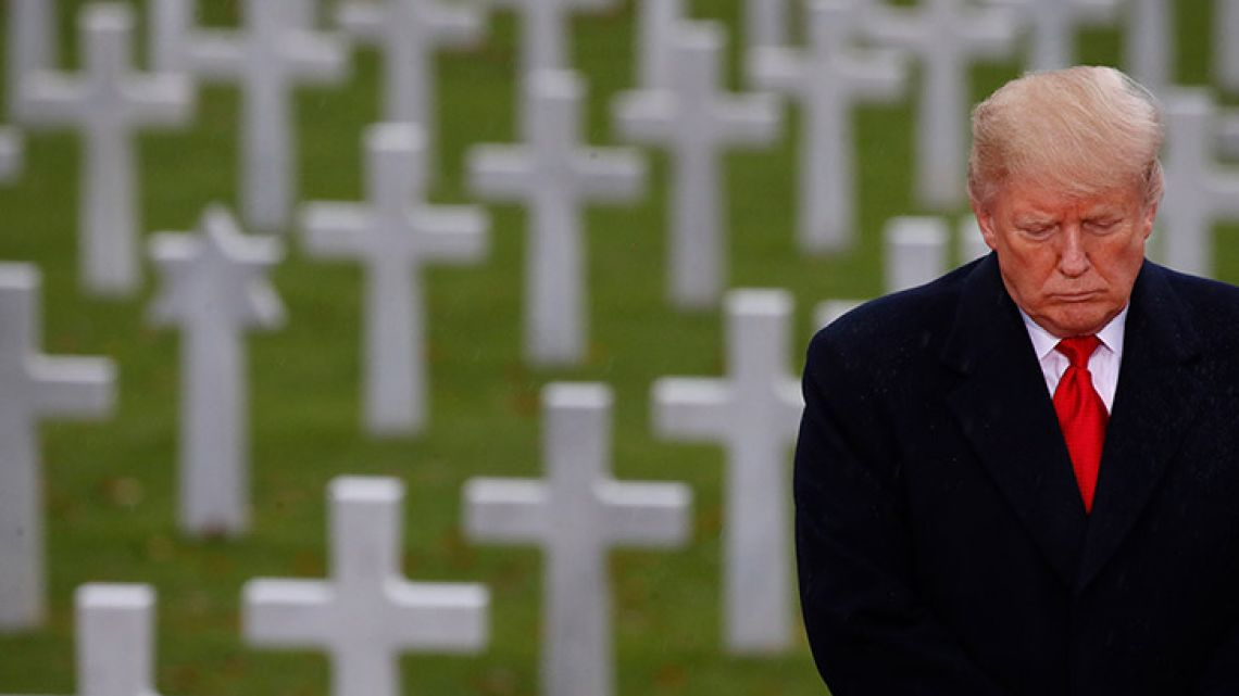 US President Donald Trump stands in front of headstones during a commemoration ceremony on November 11, 2018, at Suresnes American Cemetery near Paris.