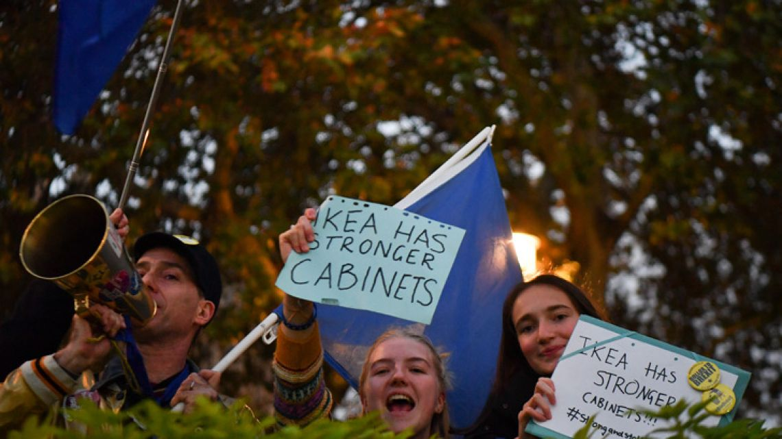 Anti-Brexit protesters shout slogans with placards and EU flags near the Houses of Parliament in central London on November 15, 2018. British Prime Minister Theresa May battled against a rebellion over her draft Brexit deal on Thursday, as ministers resigned and members of her own party plotted to oust her.