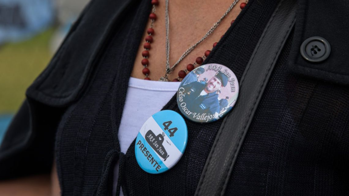 Zulma Sandoval, mother of missing submarine officer Oscar Vallejos, wears a pin with his picture outside Argentina's naval base in Mar del Plata, Buenos Aires province.