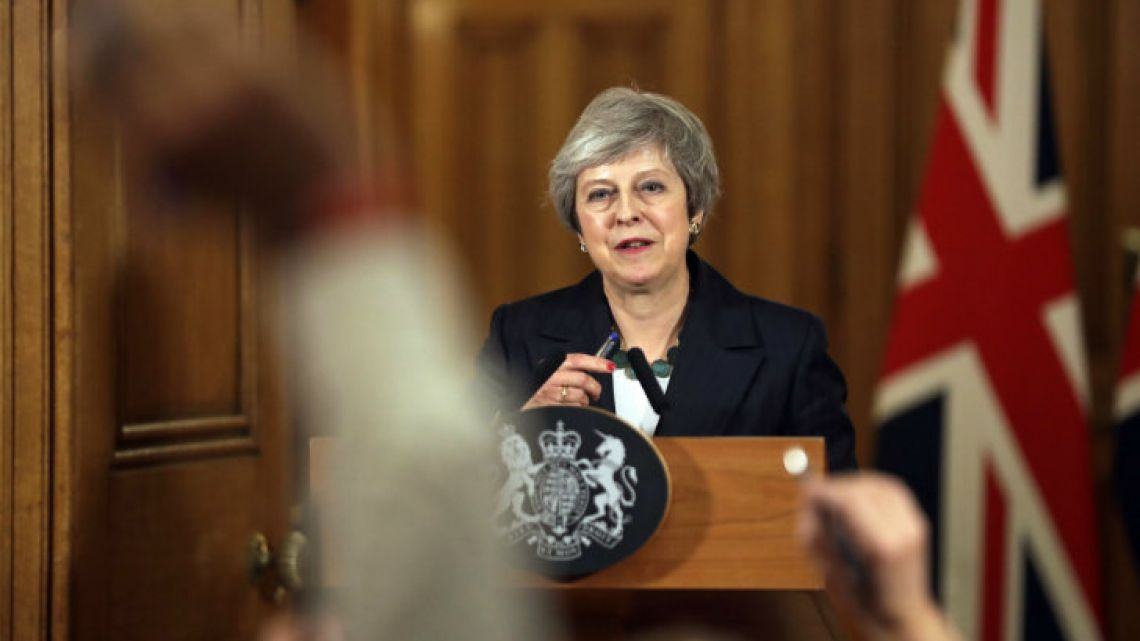 Britain's Prime Minister Theresa May reacts during a press conference inside 10 Downing Street.