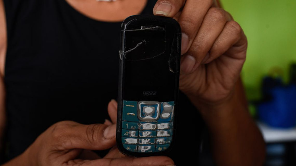 Venezuelan Yamileth Marcano, 46, shows her cellphone during an interview with AFP at her house in Caracas.