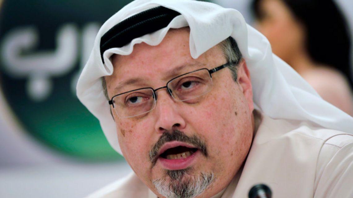 Saudi journalist Jamal Khashoggi speaks during a press conference in Manama, Bahrain, in December 2014.