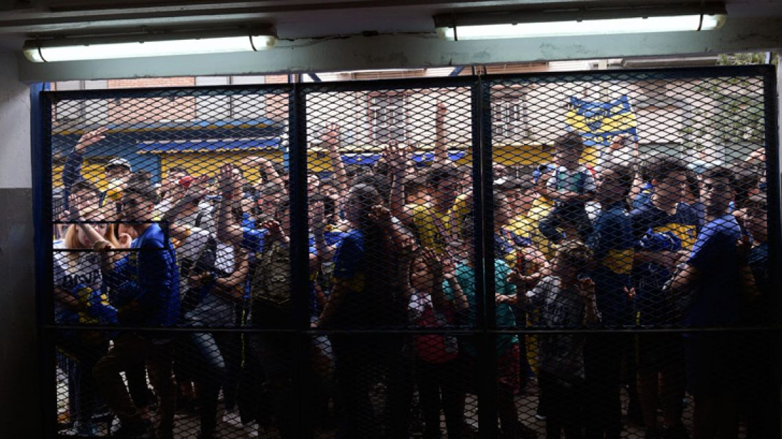 Boca Juniors fans attempt to enter the La Bombonera, ahead of an open training session at the club's stadium.