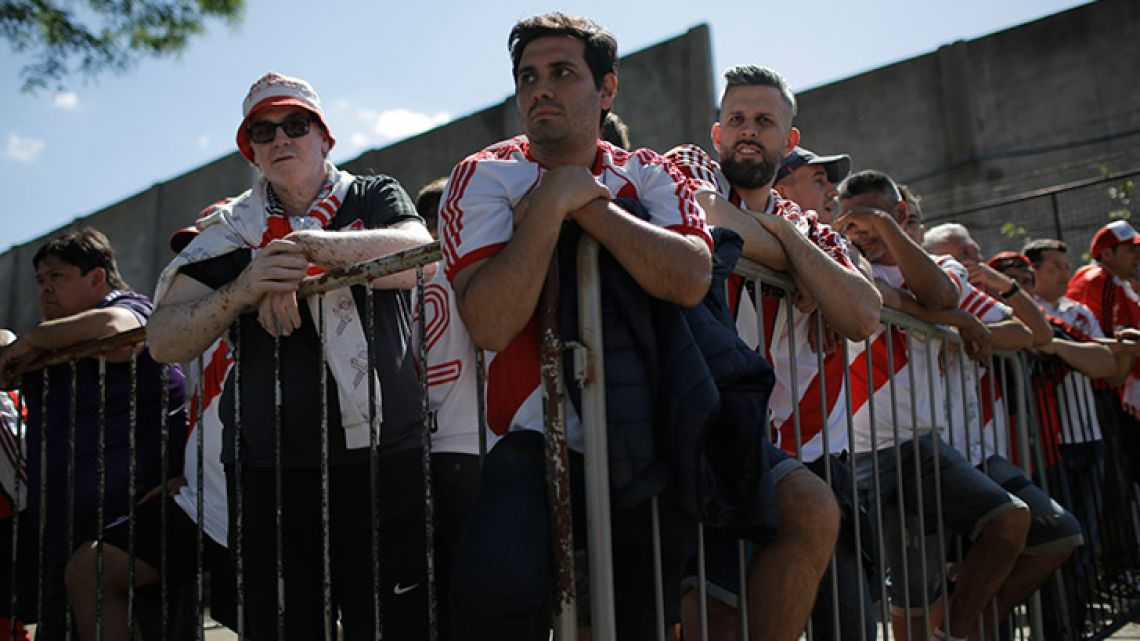 River Plate fans wait to enter the Monumental, prior the suspended match of the Copa Libertadores between River Plate and Boca Juniors on Saturday.