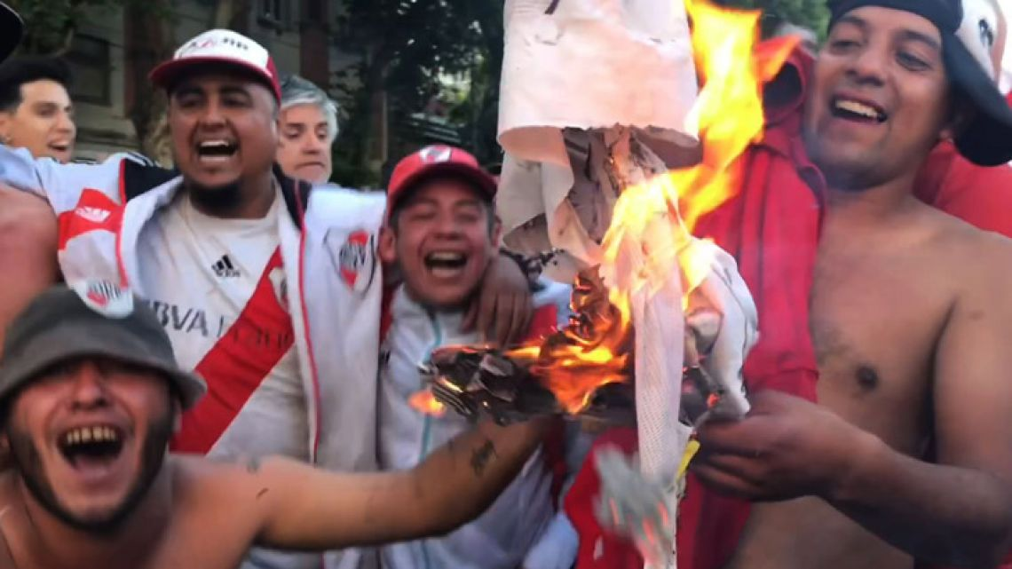 Video grab shows supporters of River Plate burning a t-shirt featuring the badge of Boca Juniors.