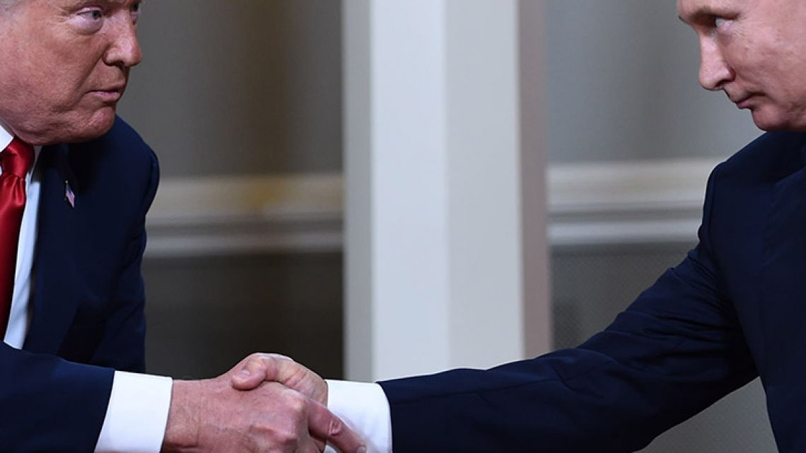 In this file photo taken on July 16, 2018, US President Donald Trump and Russian President Vladimir Putin shake hands ahead a meeting in Helsinki.