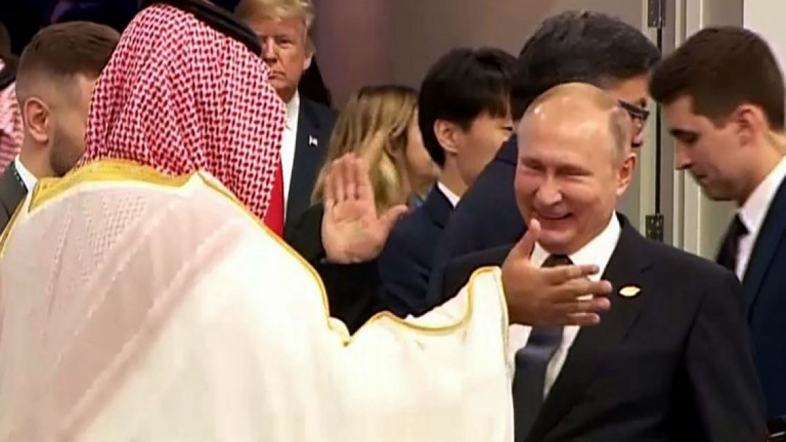 In this still image obtained from an Argentina G20 video, Russia's President Vladimir Putin (C) and Saudi Arabia's Crown Prince Mohammed bin Salman greet each other at the G20 Leaders' Summit in Buenos Aires.