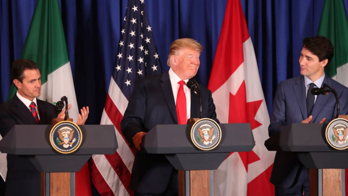 President Donald Trump, Canada's Prime Minister Justin Trudeau and Mexico's President Enrique Pena Nieto before signing a new trade Agreement during a ceremony at a hotel before the start of the G20 summit in Buenos Aires, Argentina.