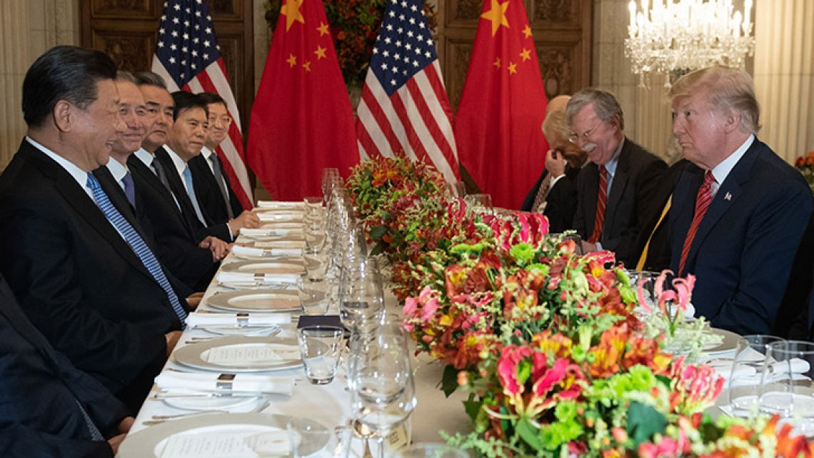 US President Donald Trump China's President Xi Jinping, along with members of their G20 delegations, hold a dinner meeting at the end of the G20 Leaders' Summit in Buenos Aires.