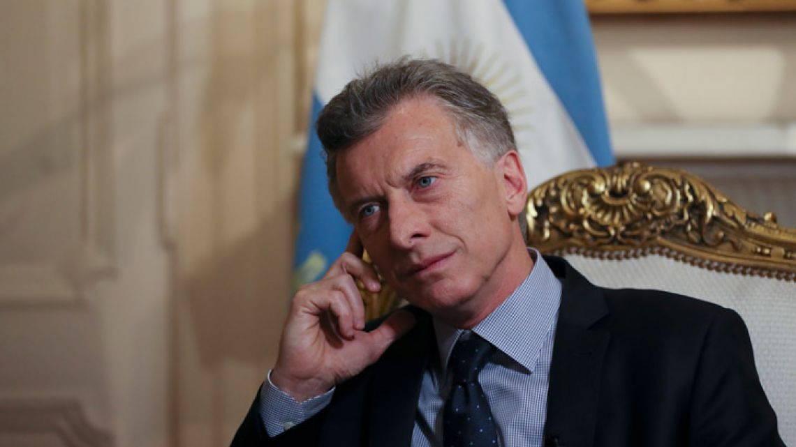 Argentina's President Mauricio Macri listens to a question during an interview at the presidential palace in Buenos Aires, Argentina.