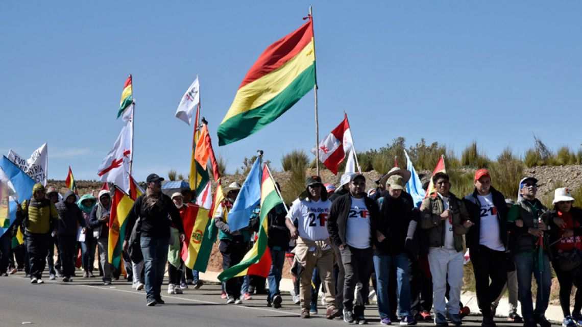 People from different regions of Bolivia march toward La Paz against the nomination of Bolivian President Evo Morales as candidate for reelection for the October 2019 national elections, in Villa Remedios, Bolivia, on December 5, 2018. The Supreme Electoral Tribunal (TSE) authorised the nomination of the Movement for Socialism (MAS) party of Evo Morales for a fourth term.