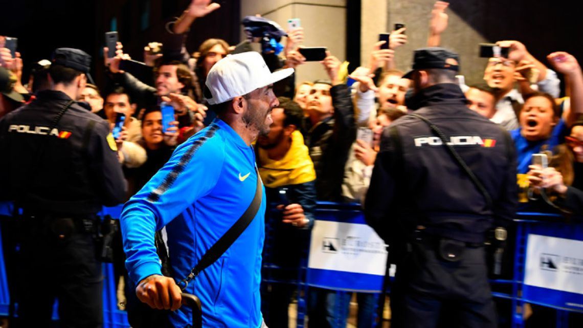 Boca Juniors forward Carlos Tevez arrives at an hotel in Madrid this evening. The second leg of the Libertadores Cup takes place in Madrid on December 9.
