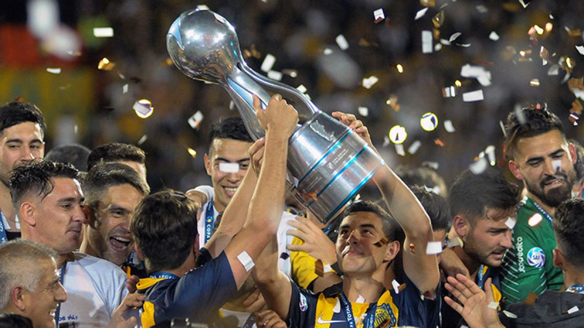 Rosario Central celebrate their Copa Argentina title, after defeating Gimnasia y Esgrima on penalties.