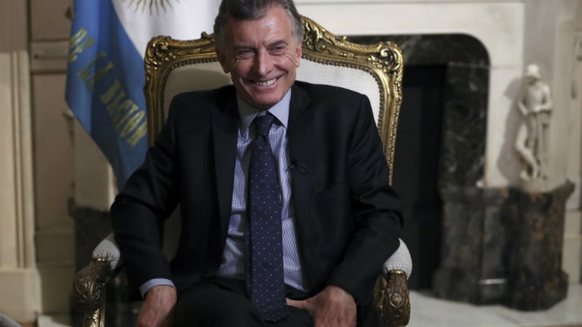 President Mauricio Macri smiles during an interview with the Associated Press on Monday.