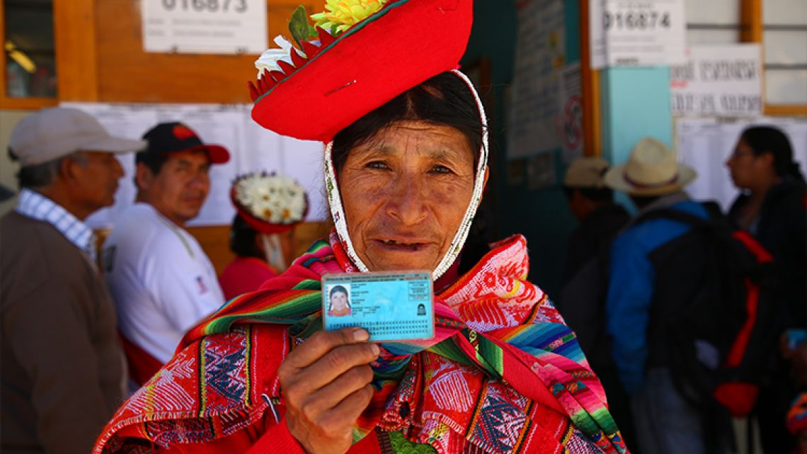 A woman outside a polling station in Ollantaytambo, Peru, where voters decided on President Martin Vizcarra's constitutional reforms aimed at eradicating corruption, on December 9, 2018.