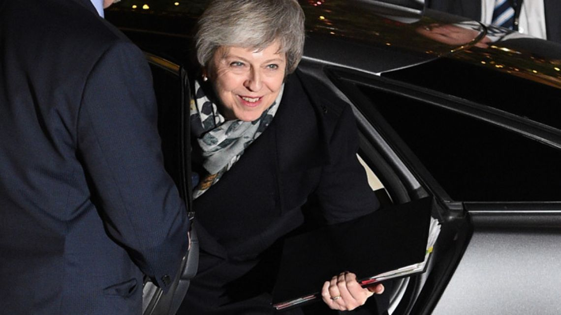 Britain's Prime Minister Theresa May arrives at 10 Downing Street in central London as she waits for the result of a confidence vote by her Conservative Party on December 12, 2018.