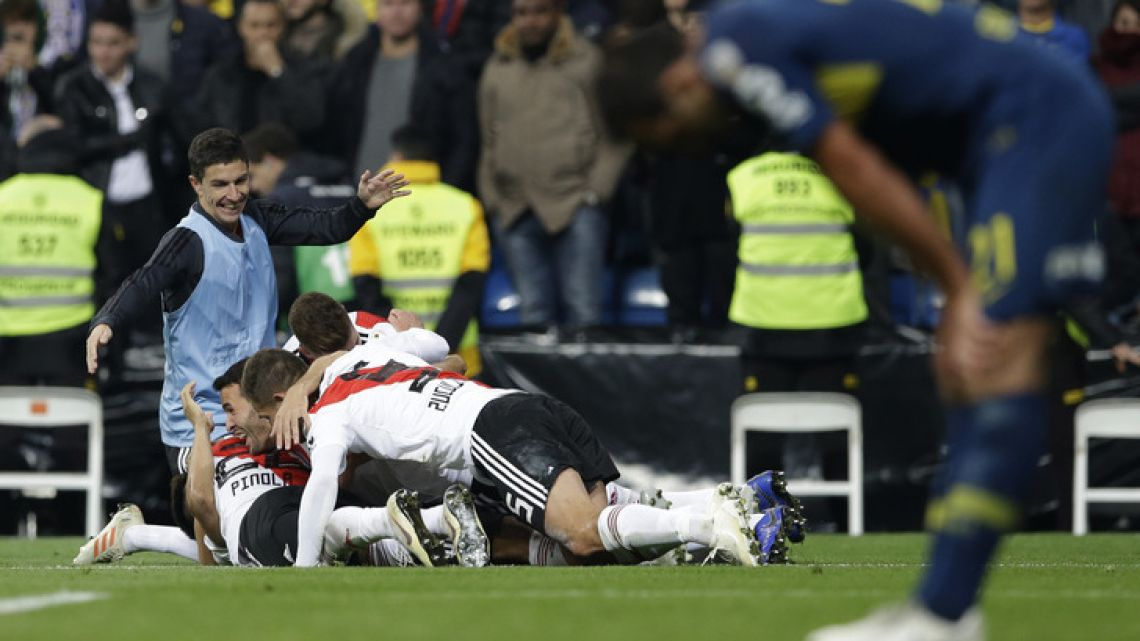 River Plate's players celebrate scoring their side's third goal during a Copa Libertadores final against Boca Juniors at the Santiago Bernabeu stadium in Madrid last Sunday.