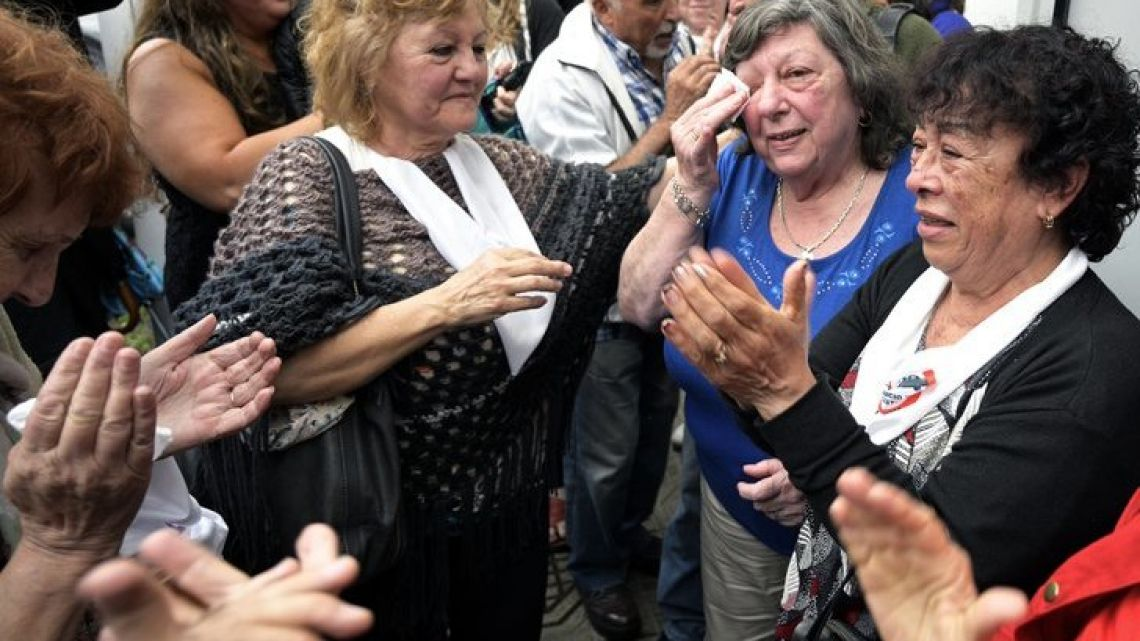 Wives of former workers at Ford Argentina and ex-political prisoners react after verdicts were handed down to former executives at the company.