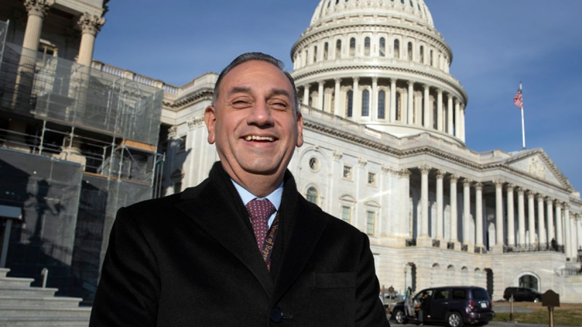 Representative-elect Gil Cisneros, Democrat-California, stands in front of the US Capitol in Washington. This year's midterm election is sending a record 43 Latinos to Congress.