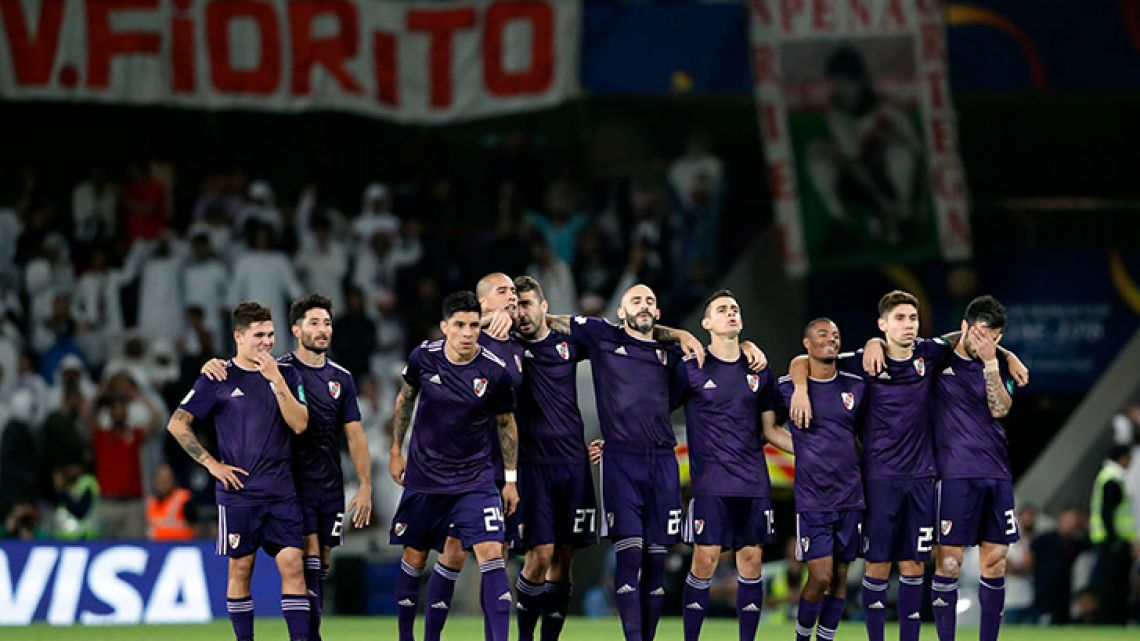 River Plate's players react after the penalty shoot-out loss in the Club World Cup semi-final match between Al Ain at the Hazza Bin Zayed stadium in Al Ain, United Arab Emirates.