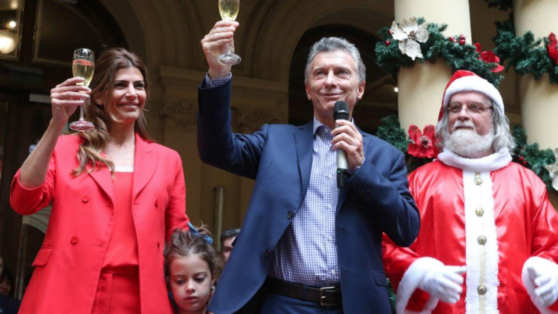 The Macri family celebrating with Santa.