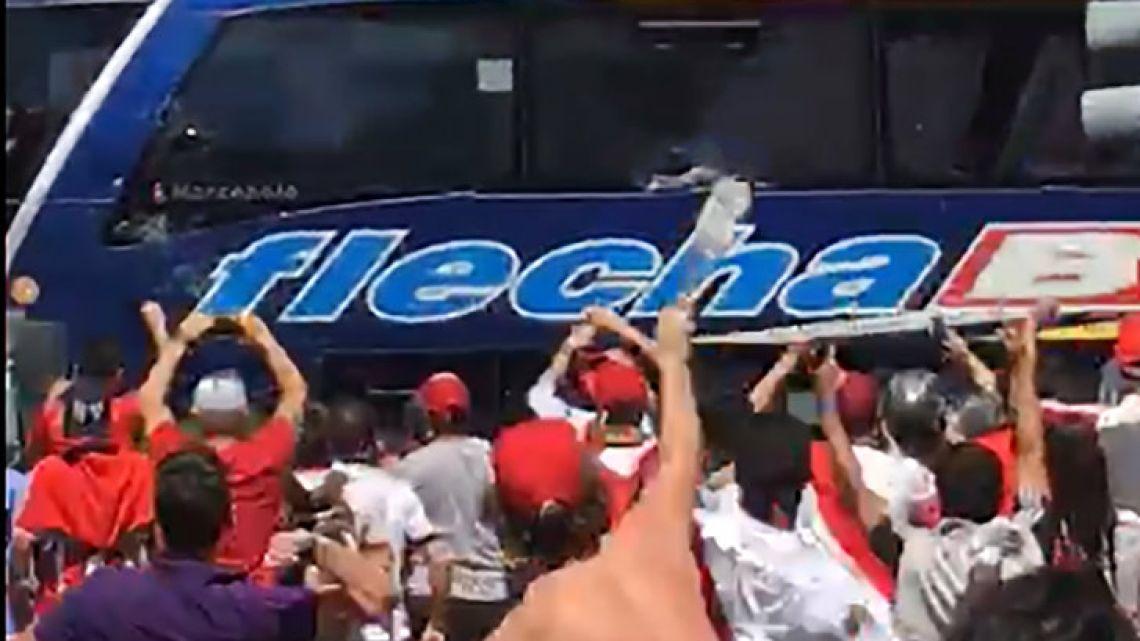 River Plate hooligans attack the Boca Juniors team bus before their Copa Libertadores clash.