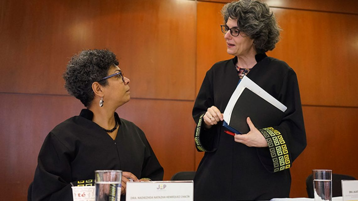 Magistrates Nadiezhda Natazha Henríquez, left, and Julieta Lemaitre speak after receiving a report from Colombia's attorney general regarding human rights violations committed during Colombia's civil conflict, in Bogotá, Colombia.